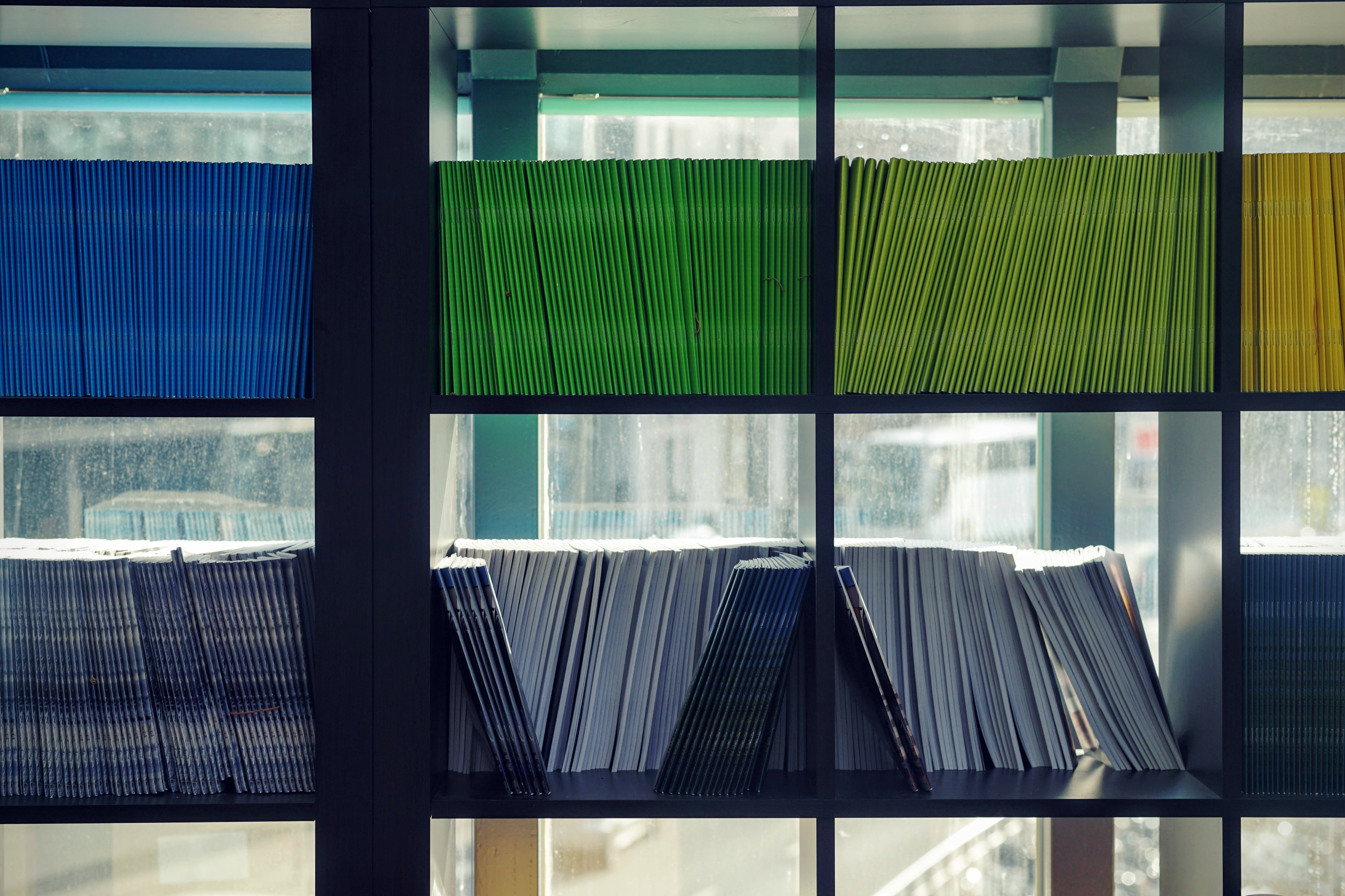 Colorful files on open shelving.